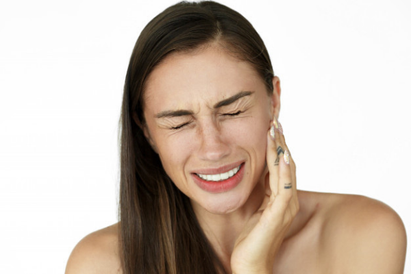 What Are The Causes and Symptoms Of Periodontal Disease?